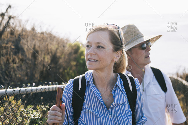 Middle-aged couple hiking at the coast