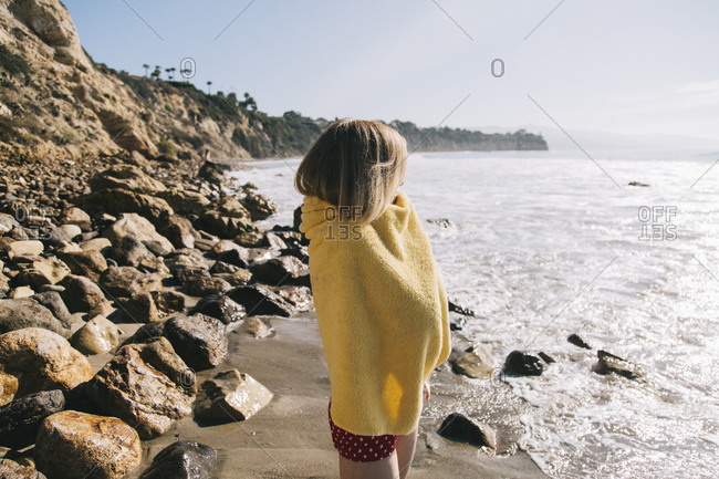 Middle-aged woman looking out at ocean at the beach