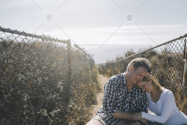 Romantic middle-aged couple at the coast