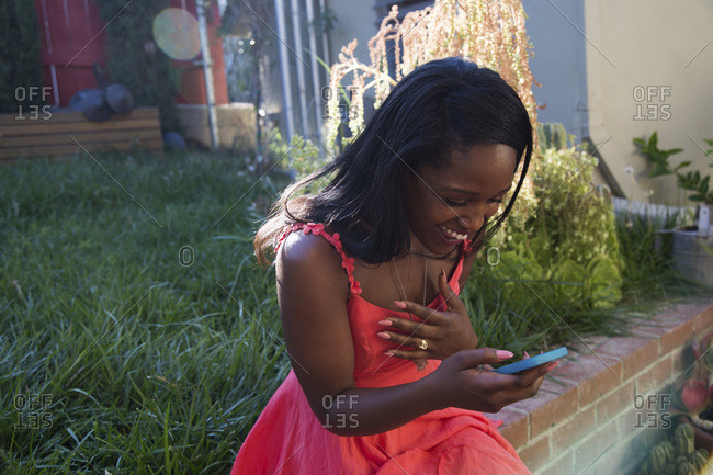 Young woman laughing at a text message