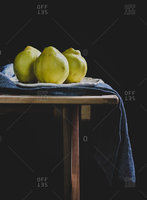 Three quince fruits on a table
