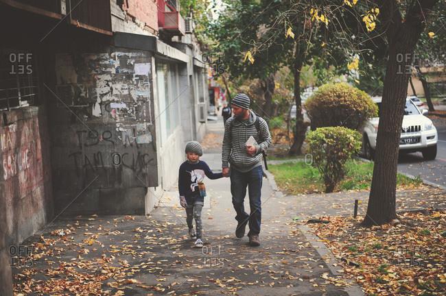 Girl and man walking down Armenian street