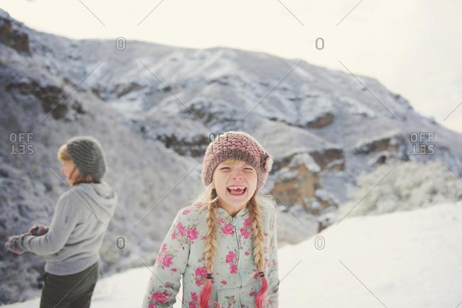 Girl laughing in wintery rural Armenia