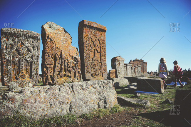 Girls exploring traditional Armenian graveyard