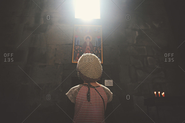 Girl looking at painting in Armenian monastery