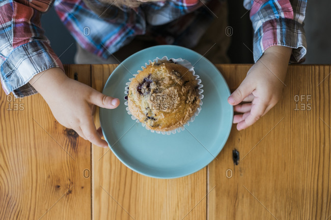 Young boy with a blueberry muffin