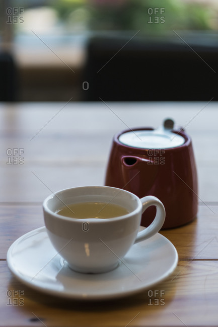 Cup of tea with pot and saucer