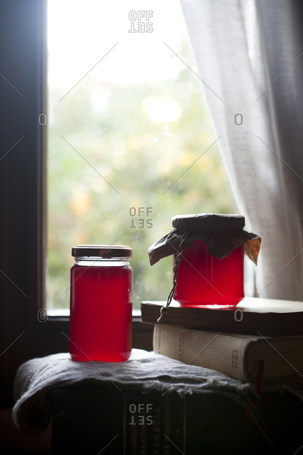 Two jars of homemade red fruit jelly