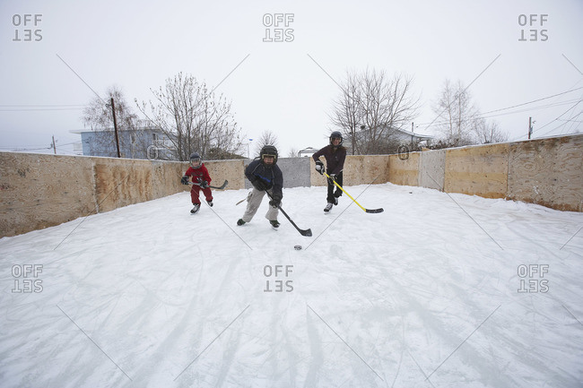 Kids Playing Ice Hockey