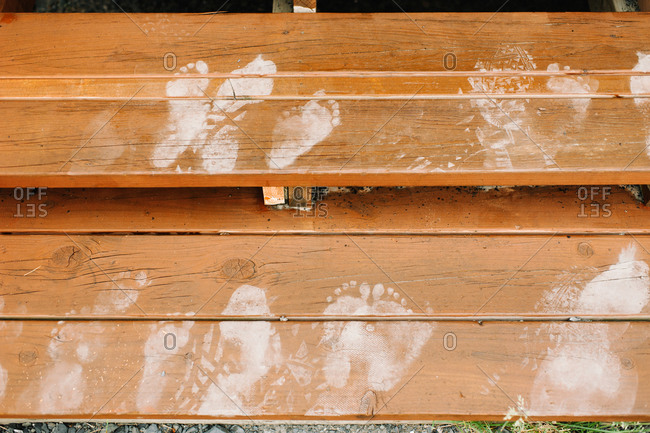 Footprints on wooden steps