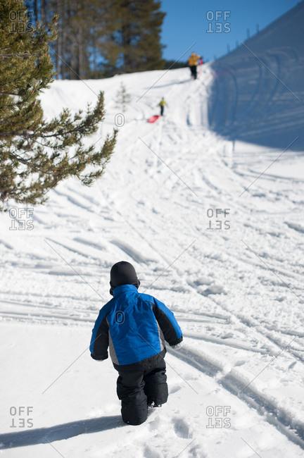 Boy at a sledding hill in winter