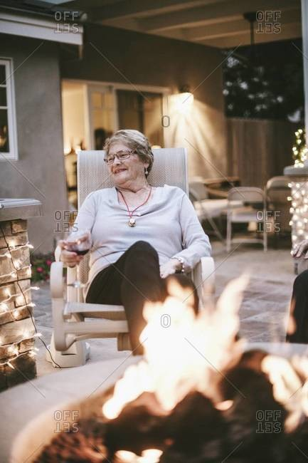 Older woman enjoying glass of wine at Christmas