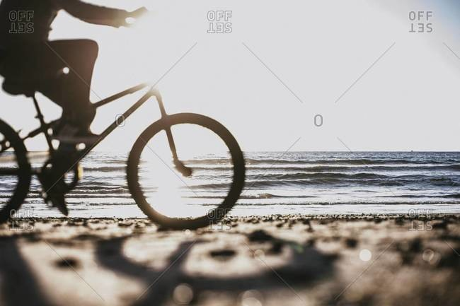 Silhouette of a bicyclist on the beach