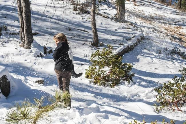 Boy getting hit by snowball in the San Bernardino Mountains, California