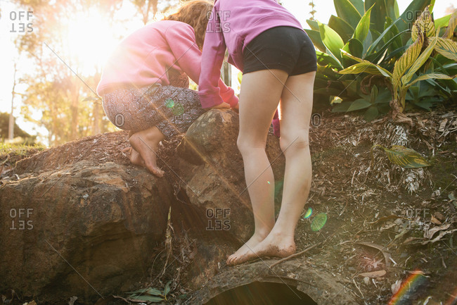 Girls looking closely at something in the dirt