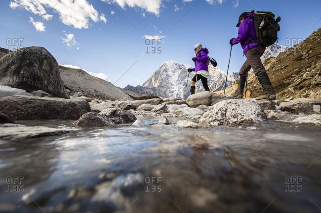 Two women are hiking a trail, Sagarmatha National Park, Khumbu region, Nepal.