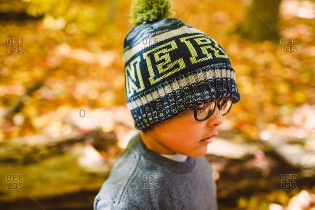 Side view of boy wearing winter beanie hat