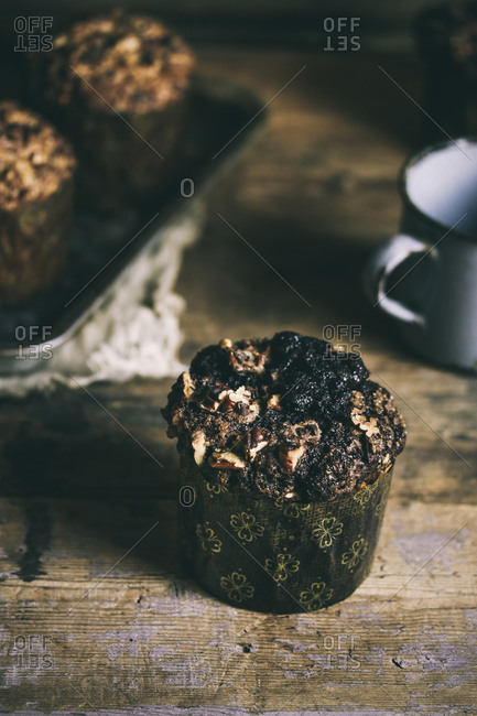 Dark chocolate muffin on wooden table