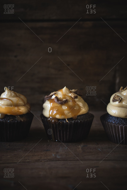 Chocolate cupcakes with peanut butter frosting and caramel drizzle