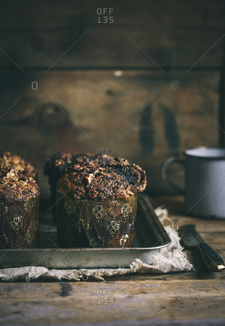 Chocolate muffins on a baking tray