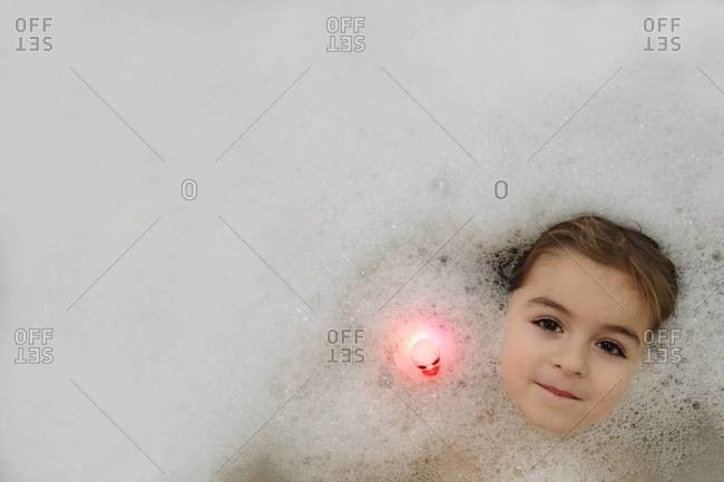 Girl's face in tub water