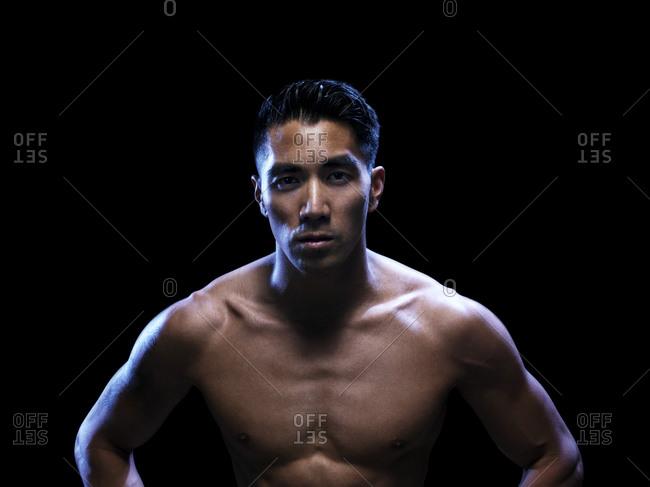 Intense male athlete with dark background