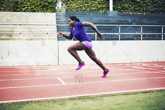 Female athlete in sprint on track