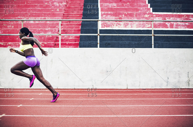 Female athlete in a sprint on track