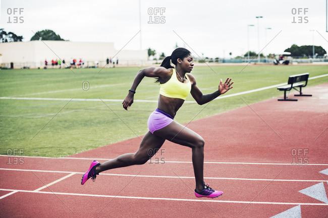 Female runner in a sprint on track