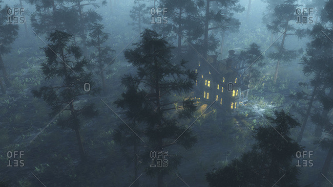 Lighted mansion in a creepy misty forest
