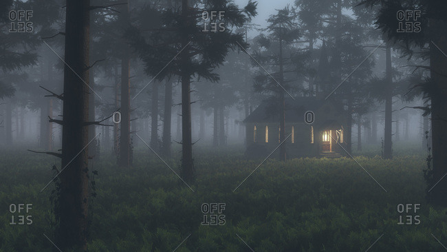 Cottage with glowing windows in a foggy forest