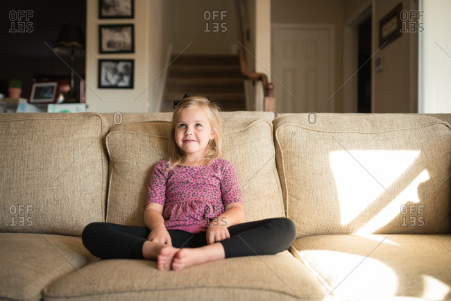 Little girl sitting on a couch