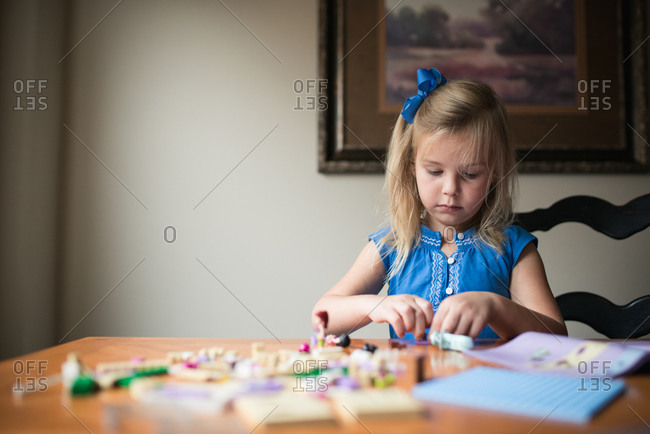 Little girl playing with small toys
