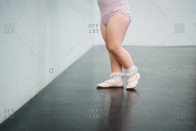 Close up of toddler ballerina in a ballet studio