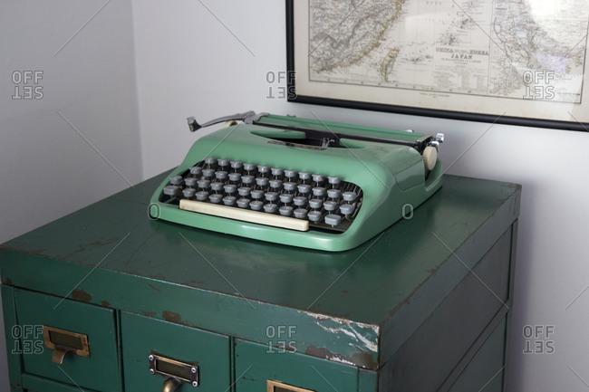 Old typewriter on metal filing cabinet