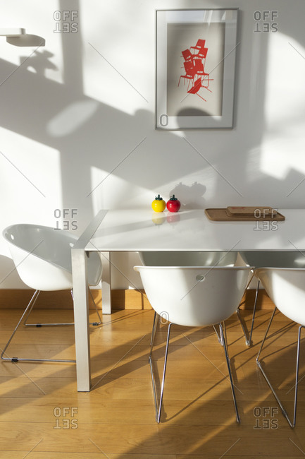 White bucket chairs and dining table