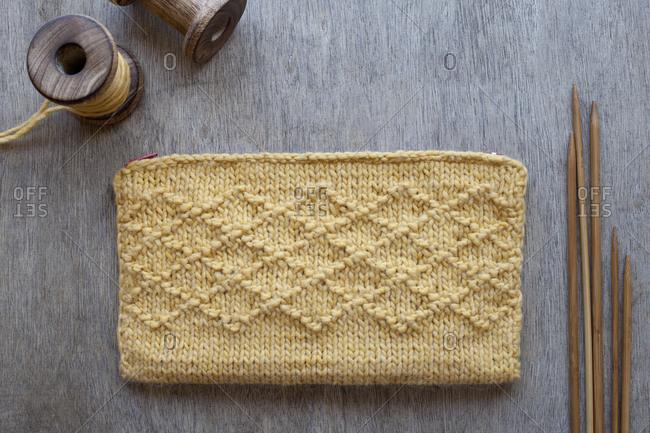 Knit purse and wood knitting needles