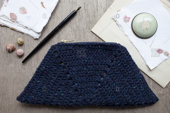 Crocheted purse and writing supplies