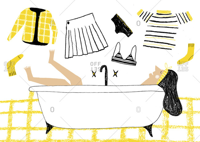 Women relaxes in bathtub with clothing scattered around