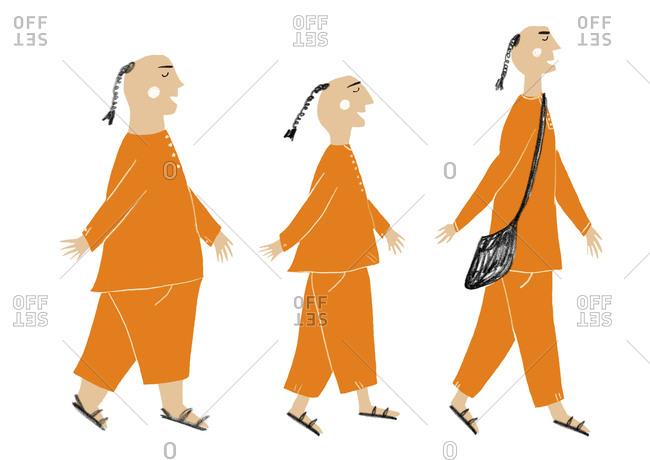 Three hari krishna followers in orange pajamas walking in a row