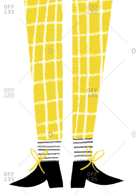 Person's legs in yellow windowpane plaid pants, striped socks and black shoes