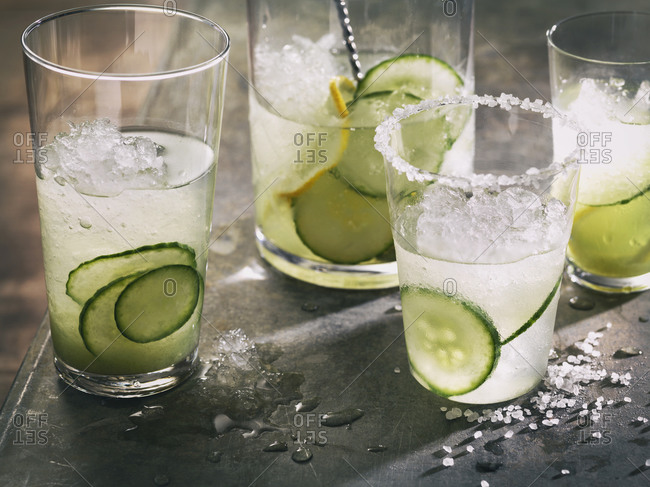 Cucumber cocktails poured from a pitcher