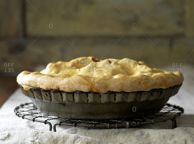Apple pie cooling on wire baking rack