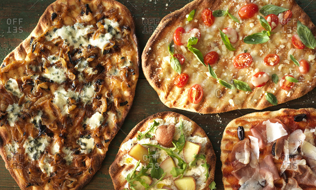 Four homemade pizzas with different toppings