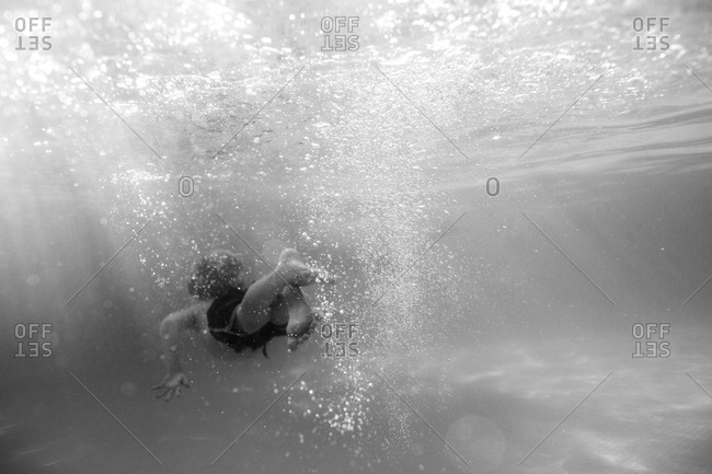 Boy swimming underwater in Huatulco, Mexico