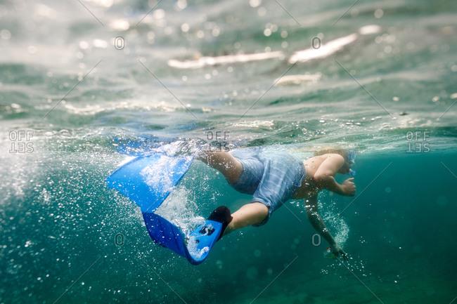 Boy snorkeling in Huatulco, Mexico