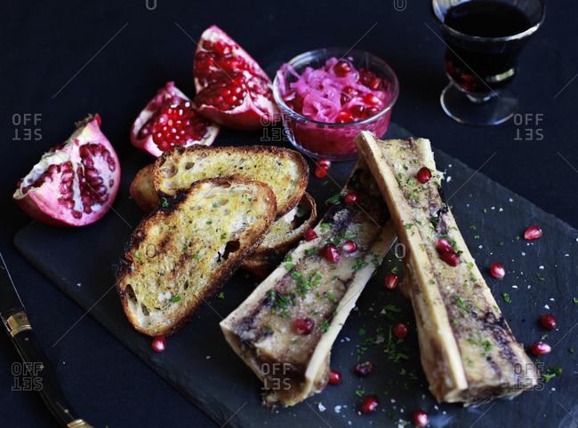Bone marrow, toast, and pomegranates