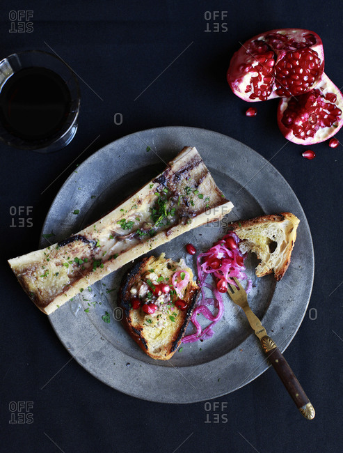 Pomegranate seeds, toast, and bone marrow