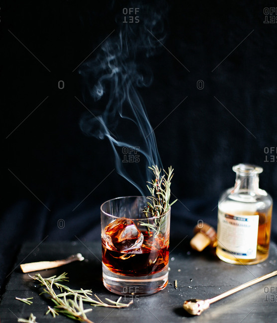 Sleepy Hollow cocktail with smoking rosemary