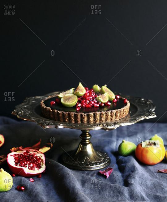 Black sesame tart on a cake stand